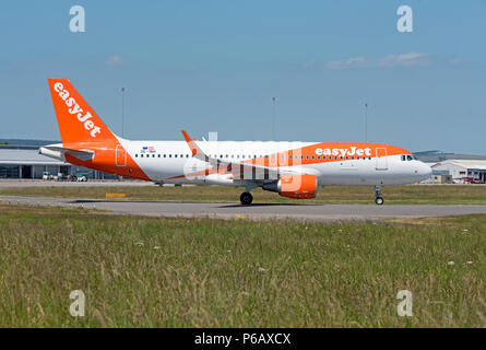 Easyjet flight ready to depart Inverness AIRPORT in the Scottish Highlands on its daily scheduled flight flight south to Gatwick airport London. - Stock Image