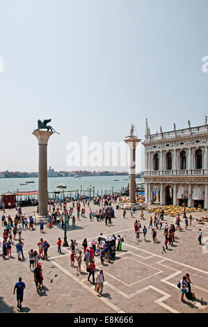 Columns of Lion of St Mark and Saint Theodore and Biblioteca Marciana overlook the sea Venice Italy Collonne di - Stock Image