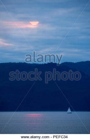 A sailboat in Stephens Passage. - Stock Image