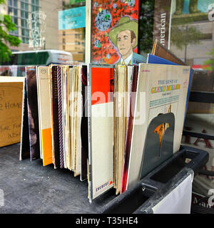 Old long playing or LP vinyl records in a record holder in front of a store in Montgomery Alabama, USA. - Stock Image