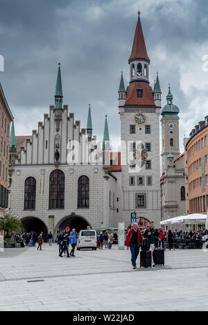 Munich, Bavaria, Germany - May 29, 2019. Tourists walking around in front of the new townhouse (Neue Rathaus) - Stock Image