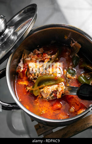 traditional spicy tomato vegetable and egg soup stew in madeira portugal - Stock Image