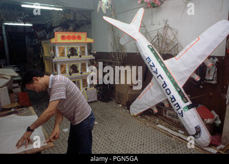 Hong Kong man creates paper effigies also known as Joss paper – traditional Chinese offerings that symbolise all the material goods one might need in the afterlife – is burned for one's deceased ancestors. It's derived from a mix of Taoism, Buddhism and regional folklore. - Stock Image