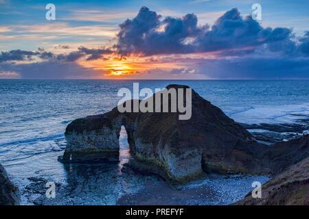 Limestone rock formation known as the Dinosaur, Flamborough Head, East Yorkshire, England, UK, sunrise. - Stock Image