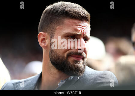 London, UK. 14th July 2019. Wimbledon Tennis Tournament, Day 13; Chelsea striker Olivier Giroud sits court side during the mens final Credit: Action Plus Sports Images/Alamy Live News - Stock Image