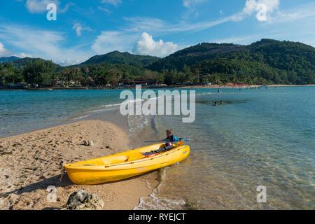 Yellow kayak in Ko Ma island beach near Phangan island, Thailand - Stock Image