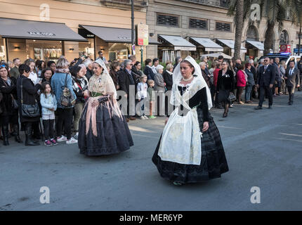 A religious catholic procession from St Marys Cathedral walk through crowds along the streets of Valencia, Spain. 9 April 2018. - Stock Image