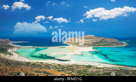 Balos lagoon on Crete island, Greece. Tourists relax and bath in crystal clear water of Balos beach - Stock Image