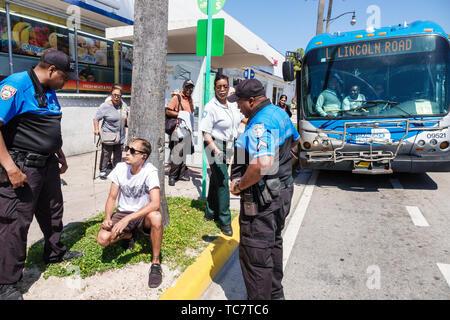 Miami Beach Florida North Beach Miami-Dade Metrobus bus public transportation disruption dispute confrontation taking law into own hands Hispanic man - Stock Image