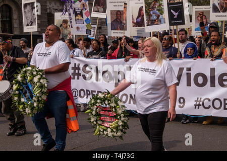 London, UK. 17th April 2019. Knife crime campaigners Operation Shutdown, a consortium of mums, dad's and other bereaved family members and loved ones supported by other campaigners, called for the community to unite and demanded more urgent action by the government to halt the growing epidemic of knife crime. They marched from Downing Street led by a drummer and two people carrying wreaths to remember PC Keith Palmer. Peter Marshall/Alamy Live News - Stock Image