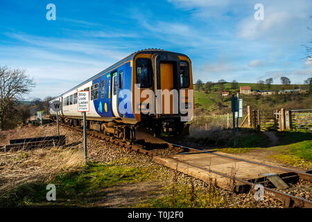 A two - car DMU Northern Rail train from Middlesbrough to Whitby passing Danby in the North Yorkshire Moors - Stock Image