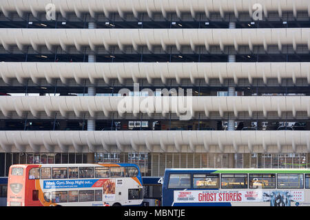 Detail of Preston Bus Station building, with two buses at the bottom of the frame. - Stock Image