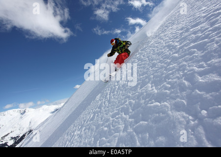 Mid adult man skiing on steep slope, Mayrhofen, Tyrol, Austria - Stock Image