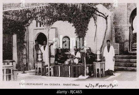 Patrons and Musicians in front of the Cafe Restaurant des Oudaya at Rabat, Morocco - Stock Image