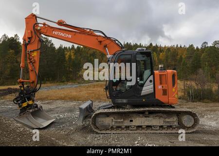 Small orange Hitachi excavator - Stock Image
