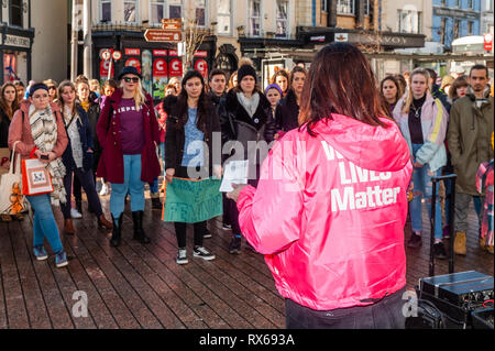 Cork, Ireland. 8th March, 2019. A crowd of between 100-150 people attended a '#Walkout 4 Equality' protest on International Women's Day on Patrick Street, Cork. The women are protesting sexual violence, the 14% pay gap and the cervical check scandal, as well as other issues. Credit: Andy Gibson/Alamy Live News. - Stock Image
