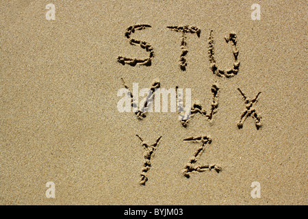 The letters S-Z written out in wet sand. Please see my collection for more similar photos. - Stock Image