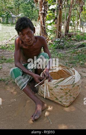 BANGLADESH Member of Koch tribal minority making a bamboo basket, Nalitabari, Mymensingh region photo by Sean Sprague - Stock Image