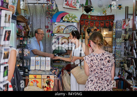 An English tourist in a gift shop in Spain - Stock Image