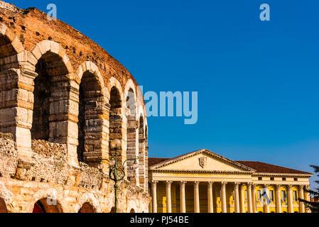 Anfiteato Arena and Palazzo Barbieri in Piazza Bra, Verona, Italy - Stock Image