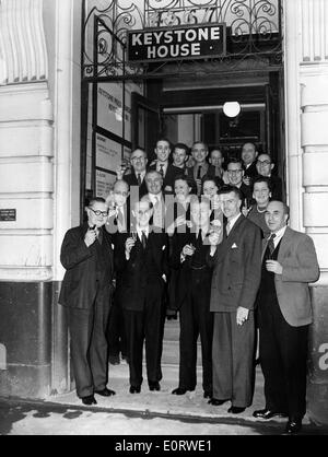 KEYSTONE journalists pose in front of Keystone House in London. - Stock Image
