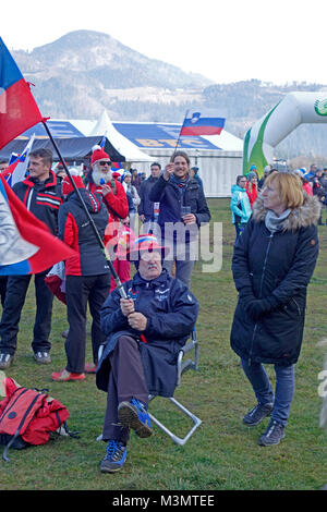 Elderly Slovene man and fan of ski jumping sport cheers with Slovenian flag. World ski jumping championship for - Stock Image