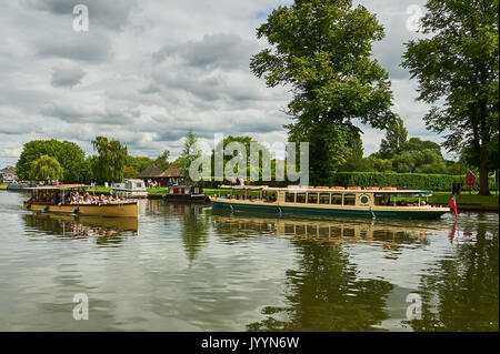 Stratford upon Avon and tourist boats on the River Avon. - Stock Image