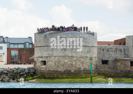 Portsmouth, UK. 25th July 2015. Crowds on top of the Round Tower in Old Portsmouth displaying the Union Flag and - Stock Image