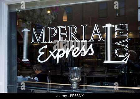 Imperial Express Café Restaurant in Northumberland Street Darlington Co Durham UK sign on the window - Stock Image
