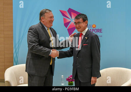 Secretary of State Michael R. Pompeo shakes hands with Japanese FM Kono at ASEAN in Singapore, Singapore, August 4, 2018. - Stock Image