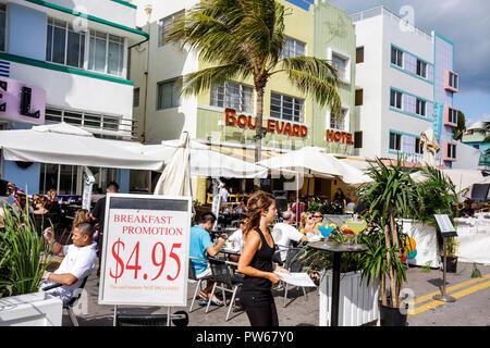 Miami Beach Florida Ocean Drive New Year's Day Art Deco District Boulevard Hotel landmark sidewalk cafe restaurant umbrellas a - Stock Image