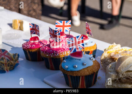 Fairly cakes with Union flags, street party,  wedding of Prince William and Meghan Markle, May 19th., 2018, Fullers Road, London E18, England. - Stock Image