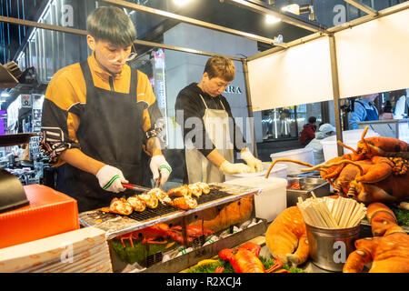 A street food stall selling grilled lobster in Myeongdong in seoul, South Korea at night. - Stock Image