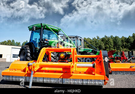 farming tractors with plow and mower, latest models - Stock Image