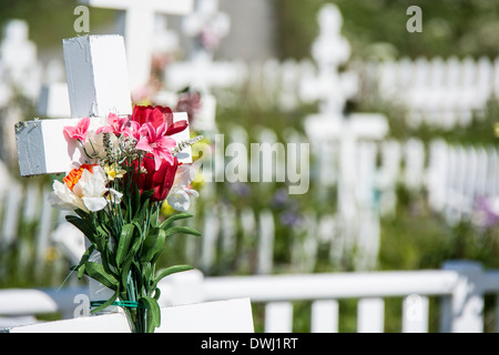 Bouquet of Flowers on a Russian Orthodox Cross in the Graveyard of Holy Transfiguration of our Lord Church, Ninilchik, Alaska - Stock Image