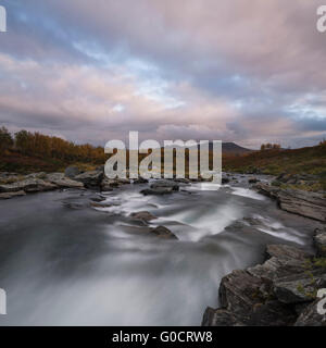 Flowing river outside of Syter hut, Kungsleden trail, Lapland, Sweden - Stock Image