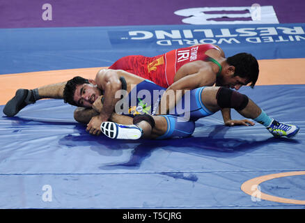 (190423) -- XI'AN, April 23, 2019 (Xinhua) -- Bahman Mohammad Teymouri (Top) of Iran competes with Parveen Rana of India during the 79KG match at 2019 Asian Wrestling Championship in Xi'an, capital city of northwest China's Shaanxi Province on April 23, 2019. (Xinhua/Li Yibo) - Stock Image