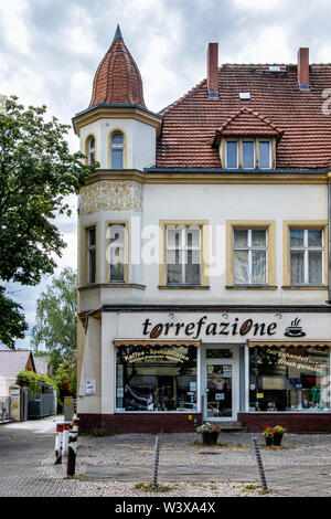 Torrefazione coffee shop in historic old listed building in Lichterfelde-Berlin. Building exterior with turret - Stock Image