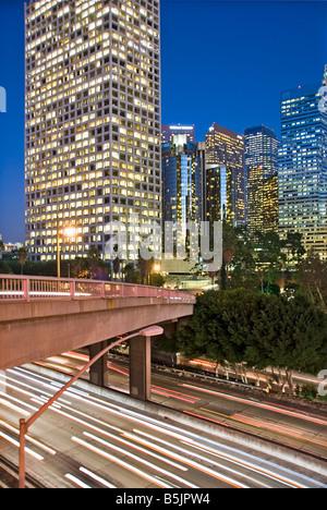 US 101, Harbor Freeway LA skyline, Dusk Los Angeles, California, USA Traffic moving CA economic, cultural,  Westin - Stock Image