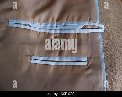 Two inner pockets of jacket close up - Stock Image