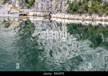 Dredging with distorted reflections Views from Lake Koman Ferry, Albania - Stock Image