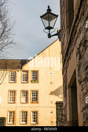 Edinburgh close or alley with old fashioned lamp post and tenement building with sash windows, Edinburgh, Scotland, UK - Stock Image