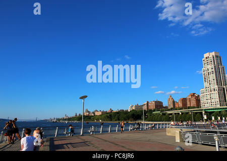 NEW YORK, NY - JULY 09: People on Pier I with Riverside waterfront in the background, West Side, Manhattan on JULY 9th, 2017 in New York, USA. - Stock Image