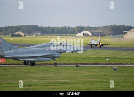 RAF Eurofighter Typhoons engaged in the 2017 Joint Warrior NATO Exercise preparing to fly out of Lossiemouth in - Stock Image