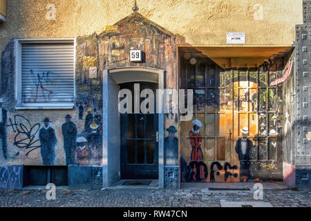 Historic urban scenes painted on facade of apartment building In Gitschiner Strasse,Kreuzberg,Berlin - Stock Image