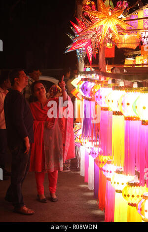Pune, India - November 2108: An Indian couple shopping for traditional lanterns for the Diwali festival in India. - Stock Image