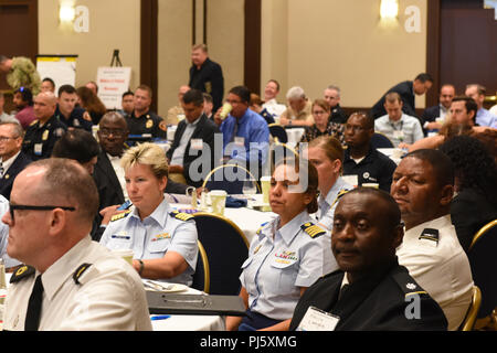 Capt. Monica Rochester, commander, Sector Los Angeles-Long Beach, and Capt. Rebecca Ore and other attendes view the presentations given at the Senior Leaders Seminars for Defense Support of Civil Authorities in San Pedro, California, August 29, 2018. This exercise provides military and federal agency leaders the opportunity to build partnerships with local, state and regional counterparts who assist in disaster preparedness and response. Coast Guard photo by Petty Officer 3rd Class DaVonte' Marrow. - Stock Image