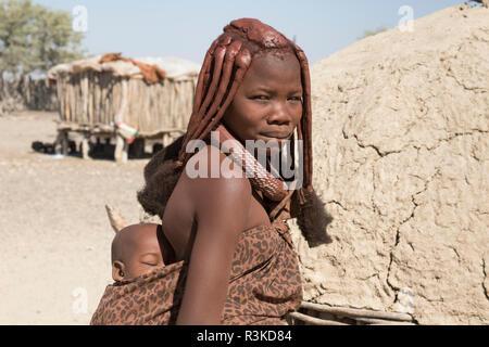 Africa, Namibia, Opuwo. Himba mother and baby. Credit as: Wendy Kaveney / Jaynes Gallery / DanitaDelimont.com - Stock Image
