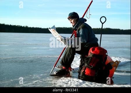 Women skater on frozen lake - Stock Image
