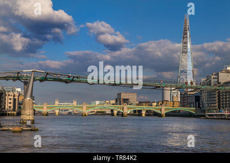 London Millennium Footbridge, The London Shard and Southwark Bridge, viewed from River Boat in late afternoon sun River Thames South Bank London SE1 - Stock Image
